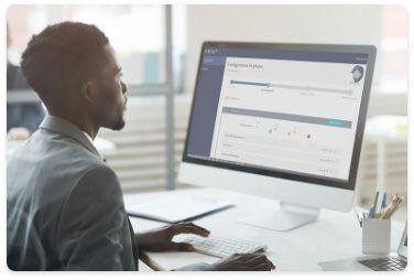 Man using fraud management AI ARIA on desktop computer